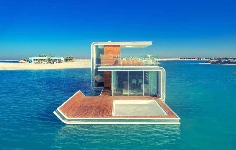 vea el v deo de las villas flotantes en las islas del mundo de dubai el correo del golfo. Black Bedroom Furniture Sets. Home Design Ideas